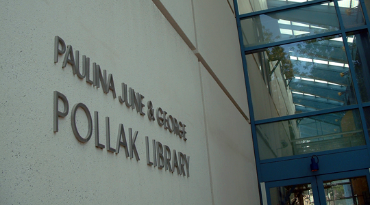 Pollak name plaque, outside east side of the library