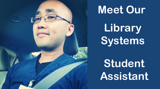 Pollak Library student assistant Adrian Dacanay